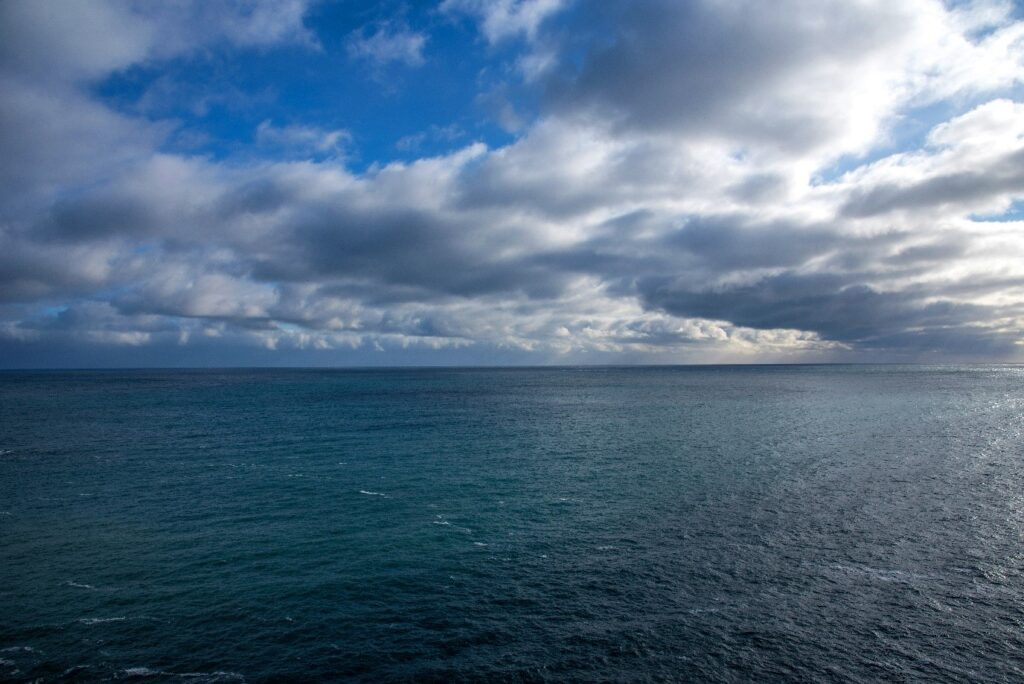 A body of water with clouds in the skyDescription automatically generated with medium confidence